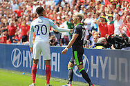 Aaron Ramsey of Wales ® argues with Dele Alli of England. UEFA Euro 2016, group B , England v Wales at Stade Bollaert -Delelis  in Lens, France on Thursday 16th June 2016, pic by  Andrew Orchard, Andrew Orchard sports photography.