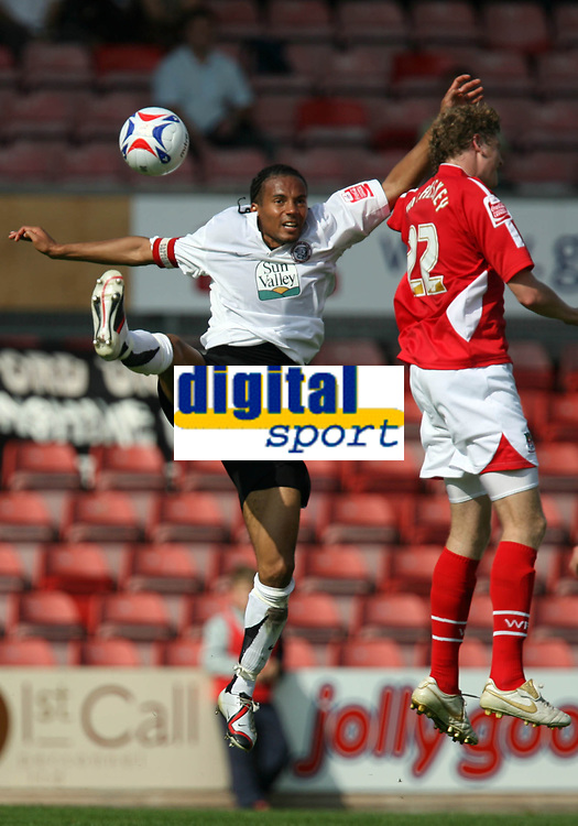 Photo: Rich Eaton.<br /> <br /> Wrexham v Hereford United. Coca Cola League 2. 24/09/2006. Herefords Mkandawire left of Hereford leaps high to foil John McAliskey of Wrexham
