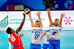 Miguel Angel Lopez Castro of Cuba vs Tine Urnaut of Slovenia and Alen Pajenk of Slovenia during volleyball match between Cuba and Slovenia in Final of FIVB Volleyball Challenger Cup Men, on July 7, 2019 in Arena Stozice, Ljubljana, Slovenia. Photo by Matic Klansek Velej / Sportida