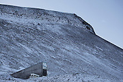 """Nestled into the rocky waste of plataberget Mountain about Svalbard's airport, the Global Seed Vault is at once startling and innocuous. Designed by architect Peter W. Søderman at Barlindhaug Consulting, this concrete, steel and glass structure is the first layer of security to a repository of millions of seeds from around the world, stored here in case of disaster, disease, or war...The Svalbard Global Seed Bank is situated 120 metres (390 ft) inside a sandstone.mountain at Longyearbyen on Spitsbergen Island, in the Svalbard archipelago about 1300km from the North Pole. Svalbard was considered ideal for the bank, due to low tectonic activity and its permafrost, which will aid preservation. Even if sea levels rise due to climate change - and the melting of ice caps, the seeds will be safe and dry , as they are stored at a location 130 metres (430 ft) above sea level. ..The Svalbard Global Seed Vault  provides a safety net against accidental loss of diversity from traditional storage within genebanks around the world, and has a capacity for 4.5 million seeds. Although the media has made much of the """"Doomsday Vault's"""" role in providing security in the face of war or or catastrophe, the operators - the Norwegian government  and the Global Crop Diversity Trust and the Nordic Genetic Resource Center - say that it will be most useful when genebanks lose samples due to mismanagement, accident, equipment failures, funding cuts and natural disasters. This mage can be licensed via Millennium Images. Contact me for more details, or email mail@milim.com For prints, contact me, or click """"add to cart"""" to some standard print options."""