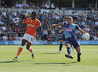 Wycombe Wanderers' Adam El-Abd clears despite the attentions of Blackpool's Joe Dodoo<br /> <br /> Photographer Kevin Barnes/CameraSport<br /> <br /> The EFL Sky Bet League One - Wycombe Wanderers v Blackpool - Saturday 4th August 2018 - Adams Park - Wycombe<br /> <br /> World Copyright © 2018 CameraSport. All rights reserved. 43 Linden Ave. Countesthorpe. Leicester. England. LE8 5PG - Tel: +44 (0) 116 277 4147 - admin@camerasport.com - www.camerasport.com
