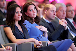 (left to right) Meghan Markle and the Duchess and Duke of Cambridge during the first Royal Foundation Forum in central London.