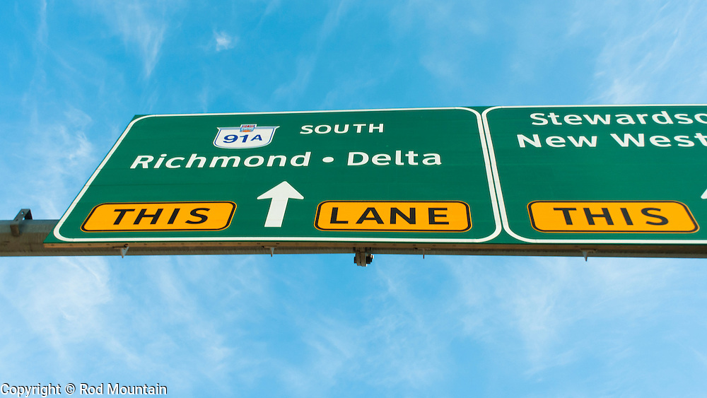 A highway sign indicating the correct lane for travel to Richmond or Delta, British Columbia