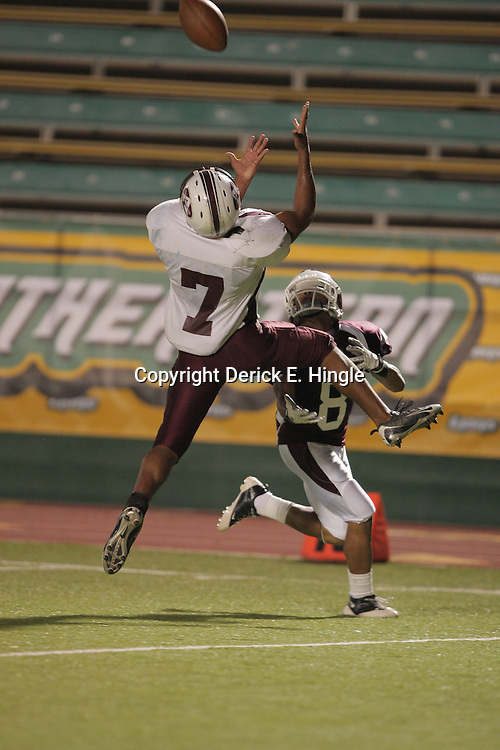 Defensive back Allen Garon #7 leaps to intercept a pass of Falcons quarterback Raymone Andrews intended for St. Thomas wide receiver Zach Reed (#8) in the first quarter against St. Thomas. The St. Thomas Falcons defeated the Albany Hornets 48-14 at Strawberry Stadium in Hammond, LA.