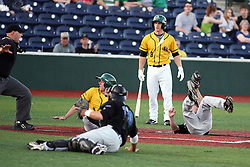 18 May 2012:  Bobby Rinard slides safely into home after taking it on a wild pitch by Dustin Williams who also comes in to cover the plate during a Frontier League Baseball game between the Windy City Thunderbolts and the Normal CornBelters at Corn Crib Stadium on the campus of Heartland Community College in Normal Illinois