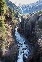 River flowing amidst rocky cliff, Venter Ache River, Otztal, Austria