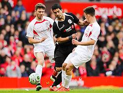 Luis Suarez loses possession - Photo mandatory by-line: Dougie Allward/JMP - Mobile: 07966 386802 - 29/03/2015 - SPORT - Football - Liverpool - Anfield Stadium - Gerrard's Squad v Carragher's Squad - Liverpool FC All stars Game