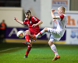RHYL, WALES - Tuesday, March 18, 2014: Wales' Mitchell Clark in action against Poland during the Under-15's International Friendly match at Belle Vue. (Pic by David Rawcliffe/Propaganda)