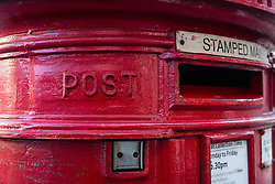 © Licensed to London News Pictures. 20/12/2016. LONDON, UK.  A postbox in east London. The Communication Workers (CW) Union have called a strike to protest against job losses , the closure of the final salary pension schemes, and selling off of large post office branches to the private sector.  Photo credit: Vickie Flores/LNP