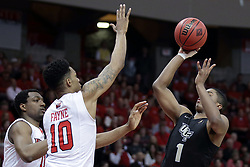 20 March 2017:  B.J. Taylor shoots over MiKyle McIntosh(11) andPhil Fayne(10) during a College NIT (National Invitational Tournament) 2nd round mens basketball game between the UCF (University of Central Florida) Knights and Illinois State Redbirds in  Redbird Arena, Normal IL