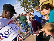13 FEBRUARY 2012 - MESA, AZ:  A campaign button vendor sells buttons and placards to rally goers in front of the Mesa Amphitheatre. Several thousand people crowded into the Mesa Amphitheatre in Mesa, AZ, Monday night to hear Republican Presidential candidate Mitt Romney speak. Romney, a Mormon, is expected to win in Arizona, which has a large Mormon population. Arizona's Republican Presidential primary is February 28.      PHOTO BY JACK KURTZ