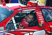 Dario Franchitti strapping himself into race car #42 at the NASCAR race Memphis Motorsports Park 2007.