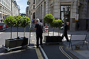 Suppliers of plants deliver shrubs to nearby offices in the City of London - the capital's financial district, on 6th June 2018, in London, England.