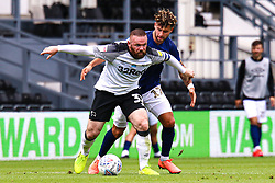 Wayne Rooney of Derby County looks for options while under pressure from Emiliano Marcondes of Brentford - Mandatory by-line: Ryan Crockett/JMP - 11/07/2020 - FOOTBALL - Pride Park Stadium - Derby, England - Derby County v Brentford - Sky Bet Championship