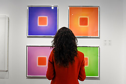 "© Licensed to London News Pictures. 03/05/2017. London, UK. A visitor views (clockwise from top left) ""Eclipsed"", ""Sunburnt"", ""Grapefruit"" and ""Agate"", all 2016, by Brian Eno at the preview of the 32nd London Original Print Fair at the Royal Academy of Arts in Piccadilly.  51 international specialist dealers are presenting works in the print medium to buyers from 4 May to 7 May. Photo credit : Stephen Chung/LNP"