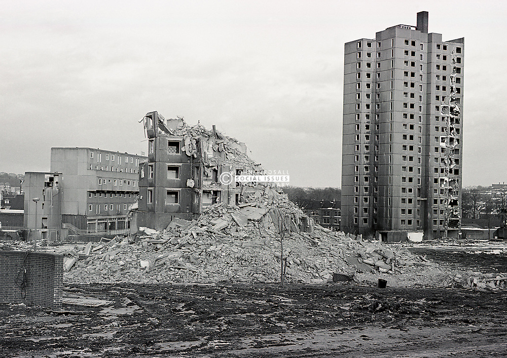 Demolition of Basford housing estate (deck access) only 17 years after they were built, Nottingham 1985 UK.  They were replaced with a new estate of traditional homes