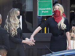 © Licensed to London News Pictures. 07/07/2020. London, UK. US actor Amber Heard (red facemask) arrives at The High Court in Central London with her sister Whitney Heard. Johnny Depp's libel trial against The Sun newspaper is due to take place over the next three weeks over allegations he was violent and abusive towards his ex-wife Amber Heard. Photo credit: Peter Macdiarmid/LNP