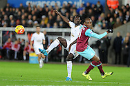 Bafetimbi Gomis of Swansea city (l) gets to the ball ahead of Angelo Ogbonna of West Ham Utd. Barclays Premier league match, Swansea city v West Ham Utd at the Liberty Stadium in Swansea, South Wales  on Sunday 20th December 2015.<br /> pic by  Andrew Orchard, Andrew Orchard sports photography.