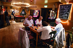 A group of people playing bingo at the local pub,