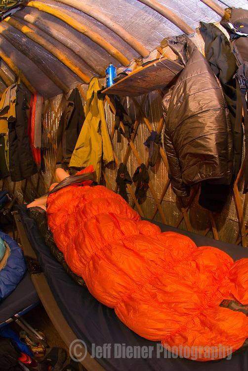 "Getting comfortable in the Wallowa Alpine Hut's ""sleeping"" yurt at McCully Basin Camp.  Wallowa Mountains, Eagle Cap Wilderness Area, Oregon."