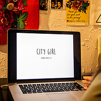 """Hannah Manuelito goes over her body of work of self-portraits titles """"City Girl"""" in preparation for her artist talk Tuesday evening June 19, 2018 at the ART123 Gallery in Downtown Gallup."""