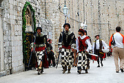 Group of men dressed in traditional period costume walk through the streets of Dobrovnik old town, Croatia