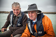 Mike Browne & Colin Monteath on fishing expedition, Okarito lagoon, West Coast, New Zealand. (Photo: Pat Morrow)