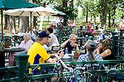People snacking at outdoor cafe. Svenskarnas Dag Swedish Heritage Day Minnehaha Park Minneapolis Minnesota USA