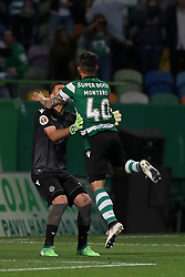 April 18, 2018 - Lisbon, Portugal - Sporting's goalkeeper Rui Patricio from Portugal (L) celebrates the victory with Sporting's forward Fredy Montero from Colombia after the Portugal Cup semifinal second leg football match Sporting CP vs FC Porto at the Alvalade stadium in Lisbon on April 18, 2018. (Credit Image: © Pedro Fiuza via ZUMA Wire)