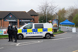 © Licensed to London News Pictures. 01/04/2021. Reading, UK. The scene on Chalfont Way, Lower Earley, Reading following a serious incident of assault outside a BP petrol station which occurred at approximately 7:40pm on Wednesday 31/03/2021, a 51-year-old man was taken to the Royal Berkshire Hospital in a critical condition with life-threatening injuries. Photo credit: Peter Manning/LNP