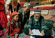 At the summer camp of Moqur in Aq Jilga valley, our friend Mullah Bichek, met in Pakistan in 2001, read the letter that we brought him from his sister Wooloka, in exile since 26 years in Turkey. The 2 hadn't been in touch since 1979.<br /> <br /> Adventure through the Afghan Pamir mountains, among the Afghan Kyrgyz and into Pakistan's Karakoram mountains. July/August 2005. Afghanistan / Pakistan.