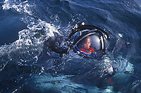 Dr. Sylvia Eale sitting in a one person submersible on the surface of the ocean.  Dr. Earle is returning from a 1,000 dive off the coast of Monterey, CA.