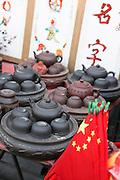 China, Beijing, Busy pedestrian street market Chinese Teapots
