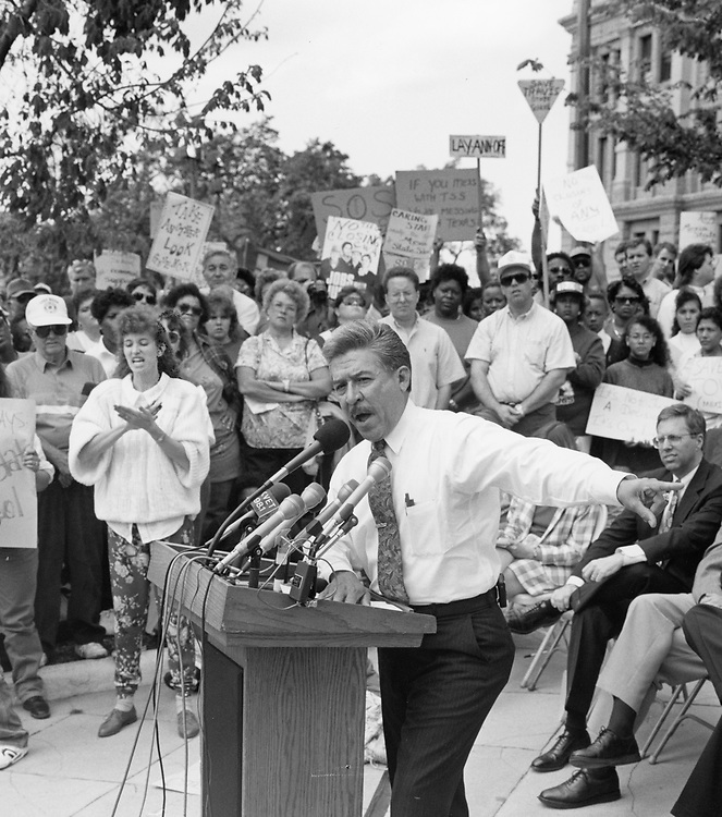 ©1992 Texas State Sen. Gonzalo Barrientos, D-Austin, talks with constituents at the Texas Capitol.