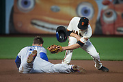 San Francisco Giants second baseman Kelby Tomlinson (37) attempts to tag Los Angeles Dodgers shortstop Corey Seager (5) out at second base at AT&T Park in San Francisco, California, on September 13, 2017. (Stan Olszewski/Special to S.F. Examiner)