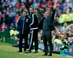 Celtic manager Brendan Rodgers with his arms in the air signals to his players during the Ladbrokes Scottish Premiership match at Celtic Park, Glasgow.