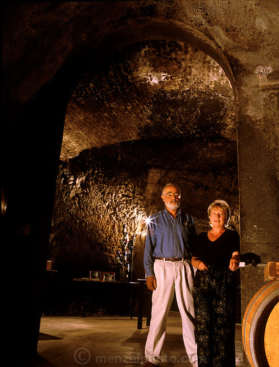 Jerry and Sigrid Seps who owns Storybook Mountain Vineyards display their wine cave which still shows pick marks left by Chinese laborers over a Century ago. Napa Valley, California. MODEL RELEASED.