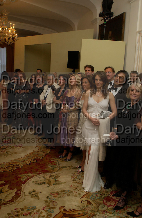 Elizabeth Hurley and Arun Nayar. An Evening in honour of Salvatore Ferragamo hosted by the Ambassador of Italy. The Italian Embassy, 4 Grosvenor Square. London W1. 8 June 2005. ONE TIME USE ONLY - DO NOT ARCHIVE  © Copyright Photograph by Dafydd Jones 66 Stockwell Park Rd. London SW9 0DA Tel 020 7733 0108 www.dafjones.com