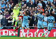 Arsenal's Laurent Koscielny tussles with Manchester City's Claudio Bravo during the FA Cup Semi Final match at Wembley Stadium, London. Picture date: April 23rd, 2017. Pic credit should read: David Klein/Sportimage