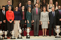 King Felipe VI of Spain, Queen Letizia of Spain, Queen Sofia of Spain and Enfant Elena of Spain pose with the awarded at the 2013 Sports National Awards ceremony at El Pardo palace in Madrid, Spain. December 03, 2014. (ALTERPHOTOS/Victor Blanco)