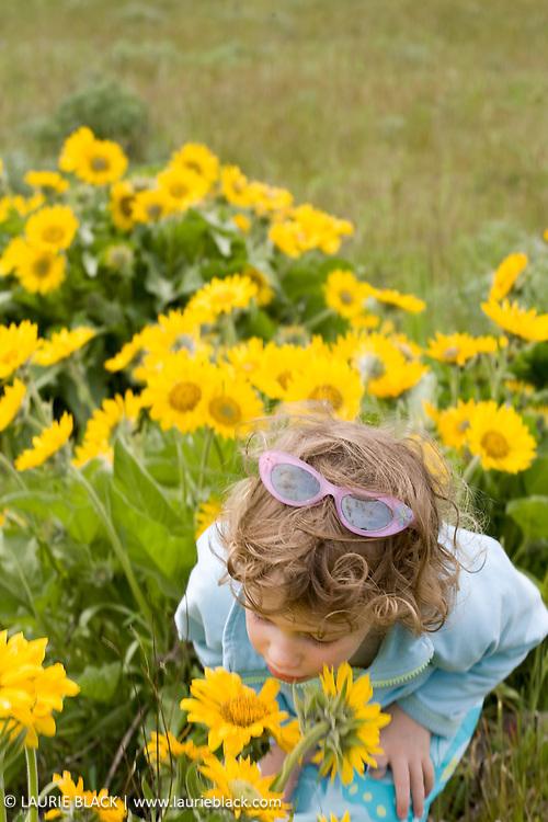 Girl smelling fragrant flowers in spring