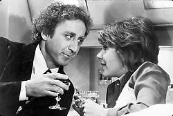 GENE WILDER, (born Jerome Silberman, June 11, 1933 - August 28, 2016) was an American stage and screen comic actor, screenwriter, film director, and author. He was known best for the lead role in the 1971 film 'Willy Wonka in Willy Wonka & the Chocolate Factory,' and the Mel Brooks comedies 'Blazing Saddles', and 'Young Frankenstein', which Wilder co-wrote, garnering the pair an Academy Award nomination for Best Adapted Screenplay. Wilder died at age 83 from complications from Alzheimer's disease. PICTURED: GENE WILDER and JILL CLAYBURGH in a scene from the 1976 film 'Silver Sreak.' (Credit Image: © SNAP/Entertainment Pictures/ZUMAPRESS.com)