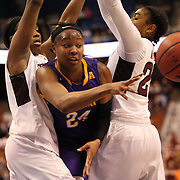 I'Tiana Taylor, (centre), East Carolina, makes a pass during the Temple Vs East Carolina Quarterfinal Basketball game during the American Women's College Basketball Championships 2015 at Mohegan Sun Arena, Uncasville, Connecticut, USA. 7th March 2015. Photo Tim Clayton