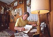 farmer in home office, farm office, family farm