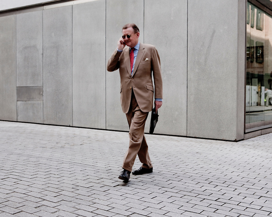 Street photography of a businessman on the phone