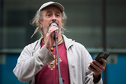 London, UK. 26th August, 2021. Environmental and housing activist Phoenix Rainbow of Climate Emergency Centres addresses activists from Extinction Rebellion, Stop HS2, XR Roads Rebellion and Paid to Pollute outside the Department for Business, Energy and Industrial Strategy (BEIS) following the Stop The Harm march on the fourth day of Impossible Rebellion protests. Extinction Rebellion are calling on the UK government to cease all new fossil fuel investment with immediate effect.