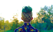 "This Guy Lost A Bet To His Cousin. The Winner Could Do The Loser's Hair<br /> <br /> Hansel Qiu's extraordinary pineapple-inspired haircut is the result of of losing a bet to his cousin. The 20-year-old student at the University of Alberta in Calgary, Canada explained how he ended with a fruit-shaved head:<br /> ""Heres a bit more background on the bet, in the beginning of the school year as motivation for school/fitness, my cousin and I decided to have a GPA/pushup bet. She ended up getting a 4.0 across the board, which I wasn't even close to,"" Qiu says. ""Luckily she's a pretty artistic and talented kind soul who IMO made my hair pretty cool!""<br /> ©Hansel Qiu/Exclusivepix Media"