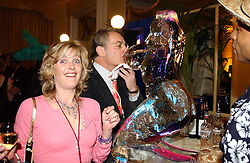 LAURA HARRIS and MR NICK MORRIS at 'A Rout' an evening of late evening party, essentially of revellers in aid of the Great Ormond Street Hospital Children's Charity and held at Claridge's, Brook Street, London W1 on 25th January 2005.<br /><br />NON EXCLUSIVE - WORLD RIGHTS