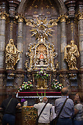 Visitors at the the church of St. Maria Victorious (Church of Our Lady Victorious – Prague Infant Jesus) located at the Lesser Town (Mala Strana) in Prague.