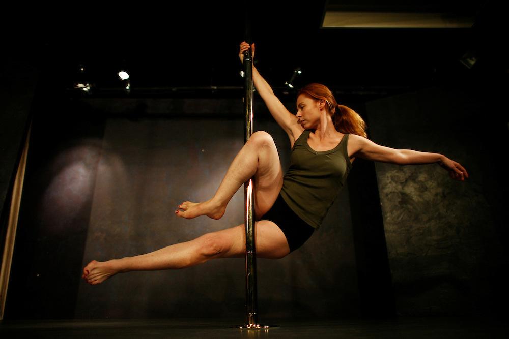 """Paris, France. October 17th 2007.A Pole Dance class at the """"Pole Dance Paris"""" School.. .Pole Dance Paris.Studio 77 .77 Rue de Montreuil.75011 Paris."""